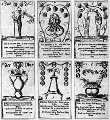 german book and 17th century teaching card tarot