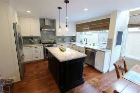 contemporary kitchen with pendant light by aplus interior design