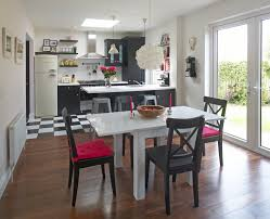 magenta accent dining room transitional with patio doors