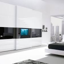 great modernized bedroom wardrobe having a television built in the
