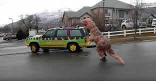 jurassic park tour car life finds a way person dressed as t rex chases a jurassic park