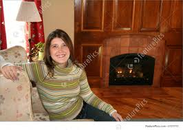 woman by a cozy fireplace stock photo i1177711 at featurepics