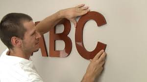 How To Hang Pictures On Wall by How To Hang Wood Letters For Signs Youtube