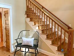pine and warm toned wood floor doors stairs and railings