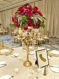 Tall Table Centerpieces by Tall Gold Candleabra With Red Roses Italian Ruscus U0026 Seeded