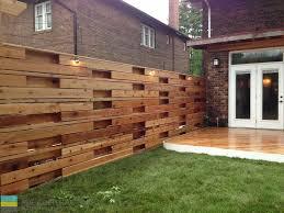 cedar deck with pergola gate and horizontal fence toronto