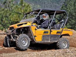 4 seater atv 2012 kawasaki teryx4 yellow left riding on dirt jpg