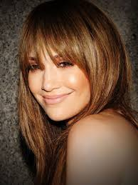 perms hairstyles permed long brunette hairstyle with bangs