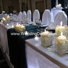 candle runners wedding decor table white linens green runners and