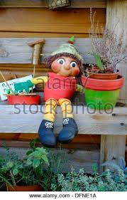 ornamental flowerpot man in garden stock photo royalty free image