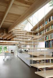 8 examples of stairs that do double duty as bookshelves contemporist