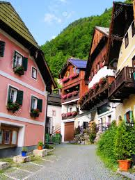 street lined with traditional wooden houses in hallstatt austria