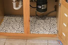 Liners For Kitchen Cabinets by Under Sink Shelf Clean Up Clutter With Sliding Shelves From