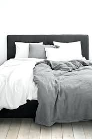 white grey bedding with charcoal almost black upholstery black