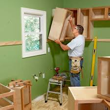 how to hang a cabinet to the wall how to install cabinets like a pro the family handyman