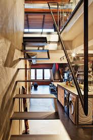 Industrial Loft Decor by Creative Staircase Design For The Urban Industrial Style Loft Of
