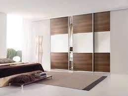 modern sliding door wardrobe u2014 office and bedroom