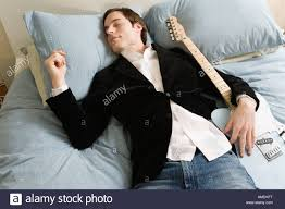 Man Sleeping In Bed Man Sleeping In Bed With Guitar Stock Photo Royalty Free Image