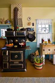 friendly colorful farmhouse kitchen old house restoration the couple uses the ca 1920 copper clad wood burning stove for cooking and