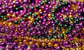 mardi gras beeds background of mardi gras with shallow dof stock photo