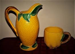 tuscan yellow pier one ceramic tuscan yellow embossed green leaf pitcher mug