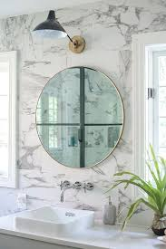 gray double bath vanity with round gold mirrors transitional