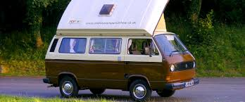 volkswagen hippie van front woody pop top campervan hire