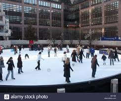 city of london broadgate outdoor ice skating rink with fun skaters