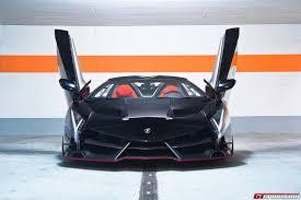 Lamborghini Veneno Body Kit - black lamborghini veneno lp750 4 roadster front angle doors up