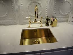 Designer Kitchen Sinks an under mounted alveus monarch gold kitchen sink in a