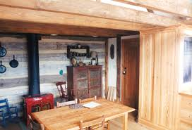 finished interior where timber frame meets log cabin handmade