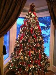 christmas tree with white lights and red bows christmas tree w velvet ribbons collected ornaments and white