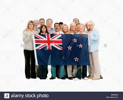 Flag People Group Of People Holding The New Zealand Flag Stock Photo Royalty