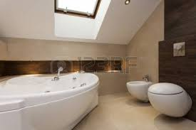 Modern Bathroom Toilet Wall Mounted Toilet In A Modern Bathroom With Travertine Tiles