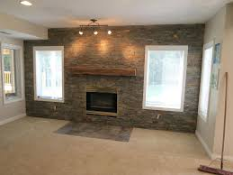 grey exposed brick stone accent wall combine wooden fireplace