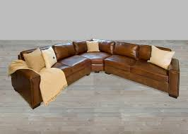 brown leather sectional sofa with nailhead trim