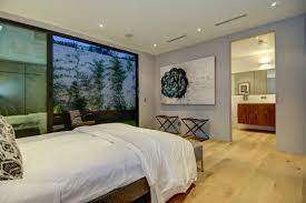 stunning bedroom design in los angeles house with white bed linen