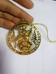 gold metal ornament wirh engraved out metal