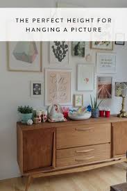 the perfect height for hanging a picture hanging art walls and
