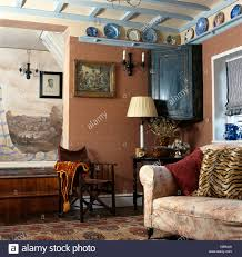 painted mural above dark wood director u0027s chair in pink cottage