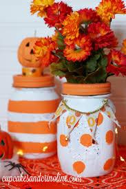 polka dot and striped halloween mason jars home with cupcakes