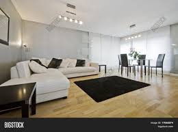 modern luxury living room with white leather corner sofa and round