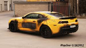 car wrapped in wrapping paper transformers bumblebee battle vinyl wrap skepple inc