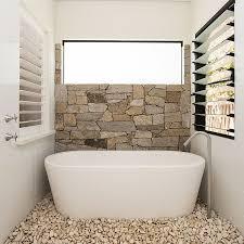wall tile bathroom bathroom tile wall tiles bathroom ideas half wall in natural stone and pebbles on the floor turn the the small bathroom into