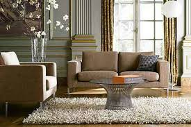neutral living room design with beige sofa and cushion also round