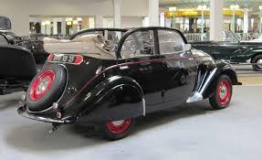 peugeot 4 door file peugeot 202 4 door cabriolet at sochaux jpg wikimedia commons