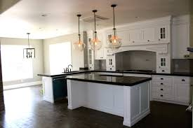 pendant lights above kitchen island with breakfast bar led