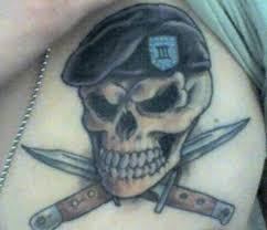 grey ink skull army on chest