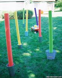 Backyard Olympic Games For Adults Stand Colorful Foam Pool Noodles In Gallon Buckets Weighted With