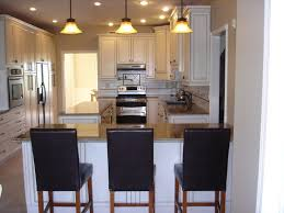 island peninsula kitchen kitchen peninsula small layout white cabinets lighting